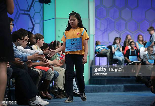 Amy Jung of Busan South Korea leaves the stage after she misspelled her word in round two of the 2016 Scripps National Spelling Bee May 25 2016 in...