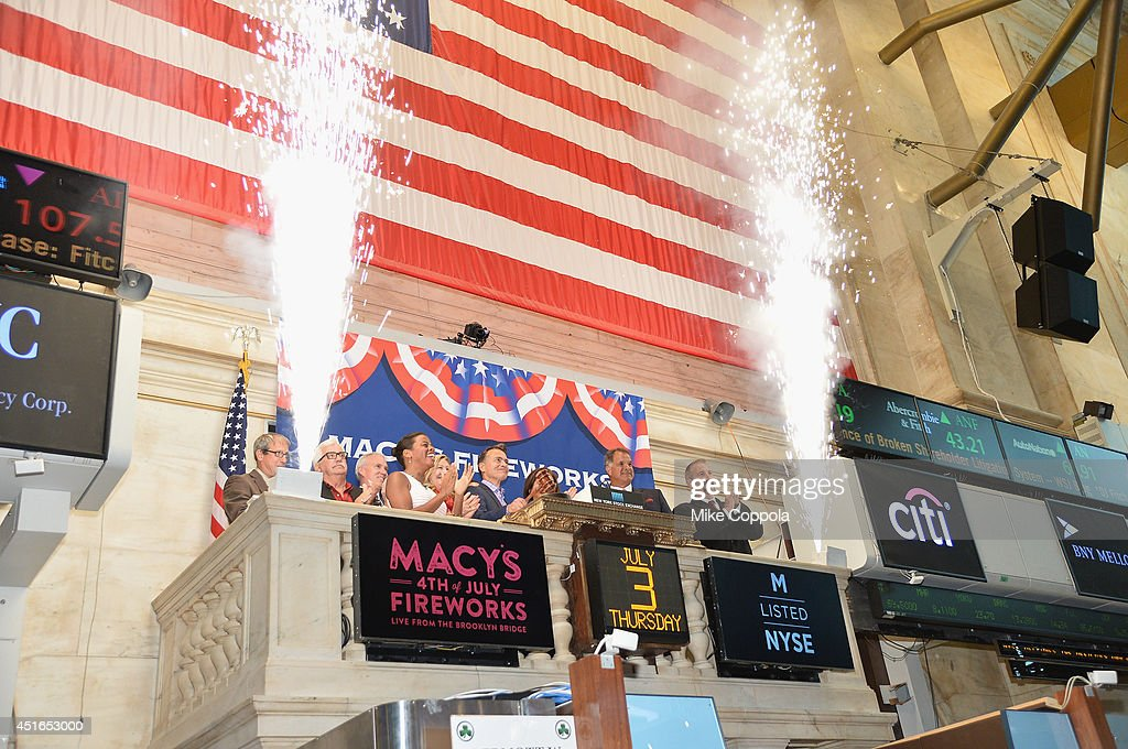 Amy Kule, Executive Producer of Macy's 4th of July Fireworks (6th from L) rings the closing bell at the New York Stock Exchange on July 3, 2014 in New York City.