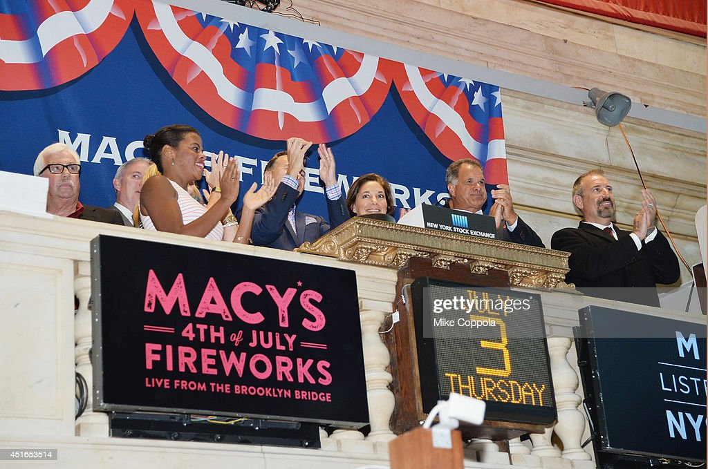 Amy Kule, Executive Producer of Macy's 4th of July Fireworks (5th from L) rings the closing bell at the New York Stock Exchange on July 3, 2014 in New York City.