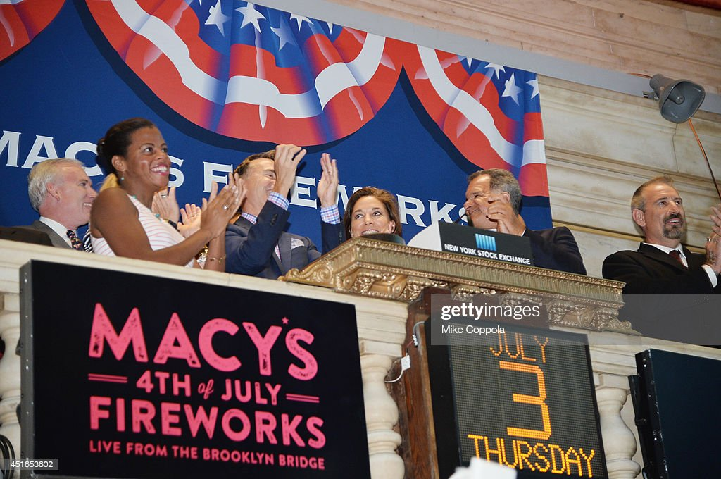 Amy Kule, Executive Producer of Macy's 4th of July Fireworks (4th from L) rings the closing bell at the New York Stock Exchange on July 3, 2014 in New York City.