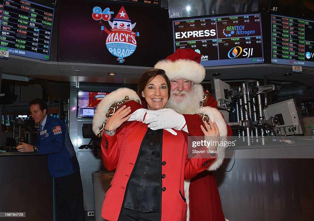 Amy Kule, Executive Producer of Macy's Thanksgiving Day Parade (R) and Santa Claus visit the New York Stock Exchange on November 21, 2012 in New York City.