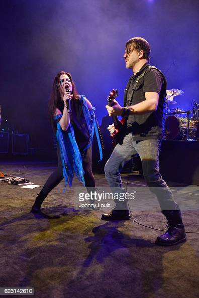 Amy Lee and Troy McLawhorn of Evanescence perform on stage at Fillmore Miami Beach on November 13 2016 in Miami Beach Florida