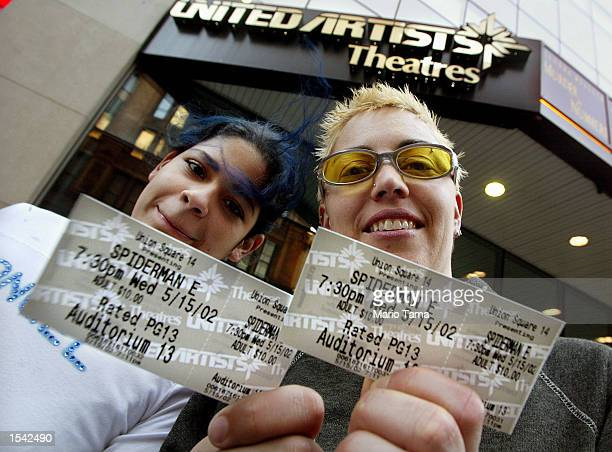 Amy Loveras and Heidi Munyer hold their tickets to the movie 'SpiderMan' outside a United Artists theater May 15 2002 in New York City The film is...