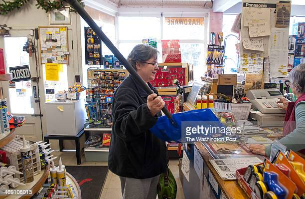 Amy McCabe of Walkersville buys snow shovel to replace one that broke at T R Saylor Co from longtime employee Doris Eyler as a major snowstorm is...