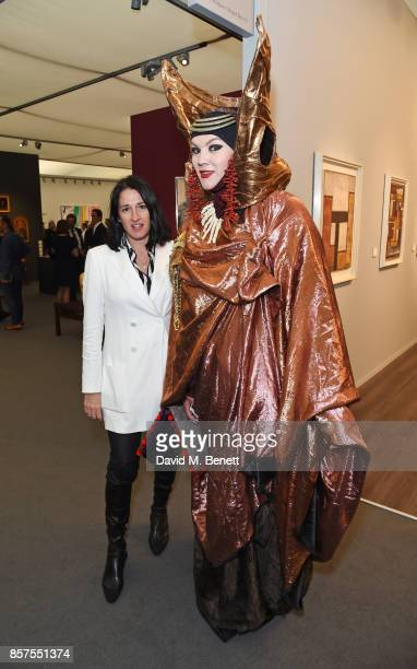 Amy Molyneaux and Daniel Lismore attend the Frieze Masters VIP preview in Regent's Park on October 4 2017 in London England