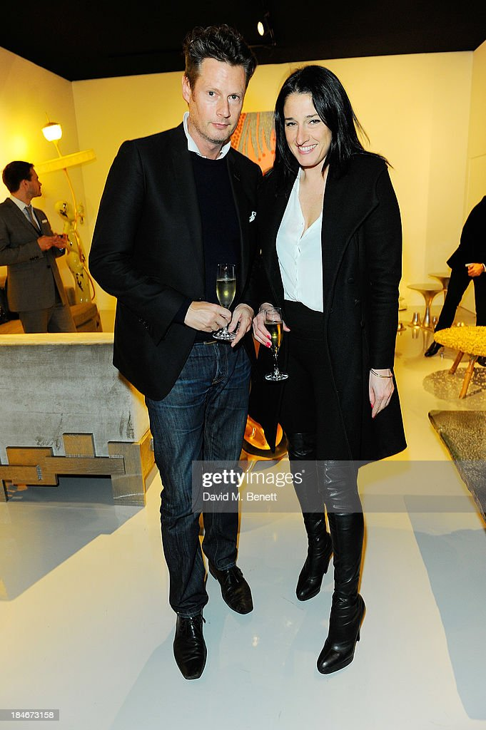 Amy Molyneaux and Percy Parker attend the Moet Hennessy London Prize Jury Visit during the PAD London Art + Design Fair at Berkeley Square Gardens on October 14, 2013 in London, England.