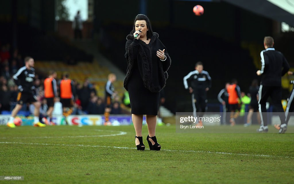 Amy Mottram sings prior to the FA Cup Fourth Round match between Southend United and Hull City at Roots Hall on January 25, 2014 in Southend, England.