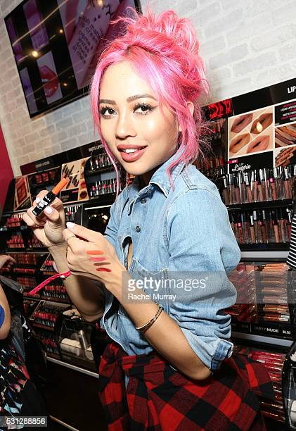 Amy Pham @iamamypham shows off her lip color swatch picks during the NYX Professional makeup store grand opening ribbon cutting celebration at...