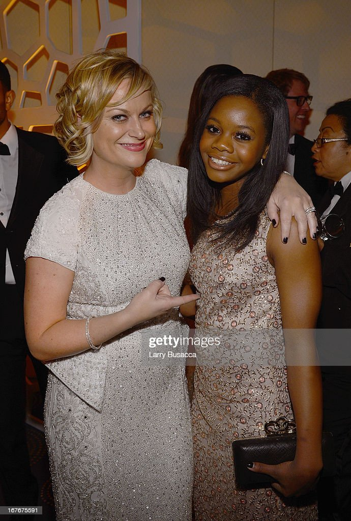 <a gi-track='captionPersonalityLinkClicked' href=/galleries/search?phrase=Amy+Poehler&family=editorial&specificpeople=228430 ng-click='$event.stopPropagation()'>Amy Poehler</a> and Olympic gymnist <a gi-track='captionPersonalityLinkClicked' href=/galleries/search?phrase=Gabby+Douglas&family=editorial&specificpeople=8465211 ng-click='$event.stopPropagation()'>Gabby Douglas</a> attend the TIME/CNN/PEOPLE/FORTUNE Pre-Dinner Cocktail Reception at Washington Hilton on April 27, 2013 in Washington, DC.