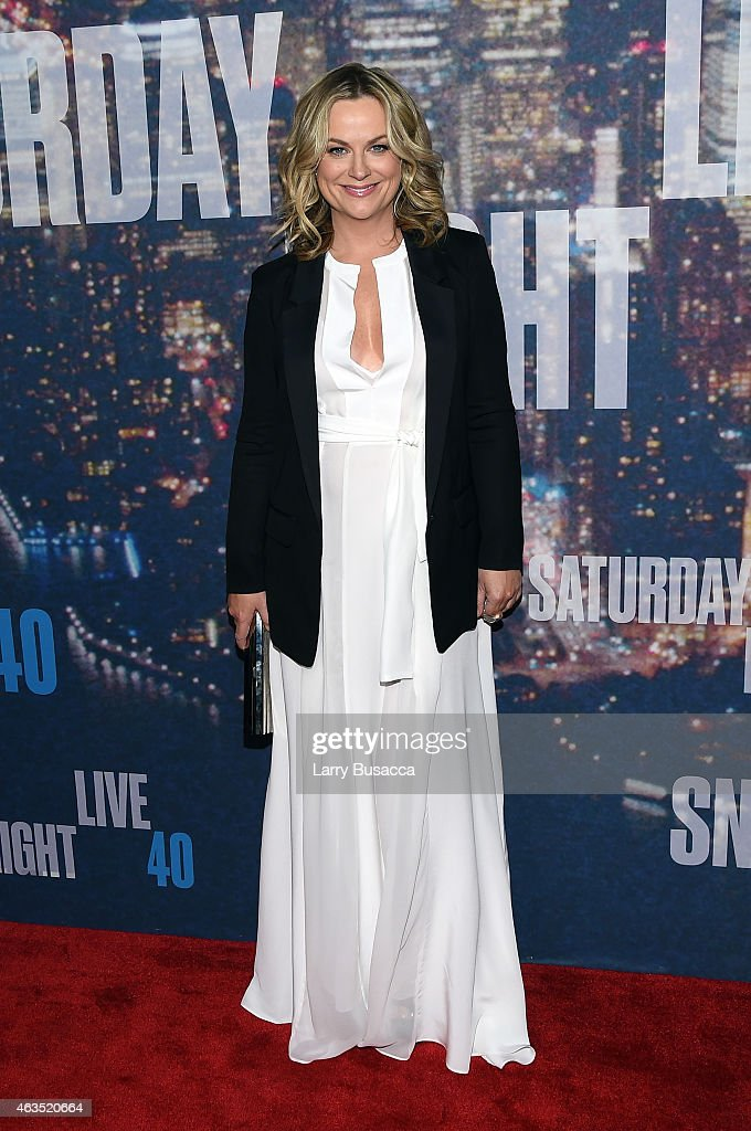 <a gi-track='captionPersonalityLinkClicked' href=/galleries/search?phrase=Amy+Poehler&family=editorial&specificpeople=228430 ng-click='$event.stopPropagation()'>Amy Poehler</a> attends SNL 40th Anniversary Celebration at Rockefeller Plaza on February 15, 2015 in New York City.