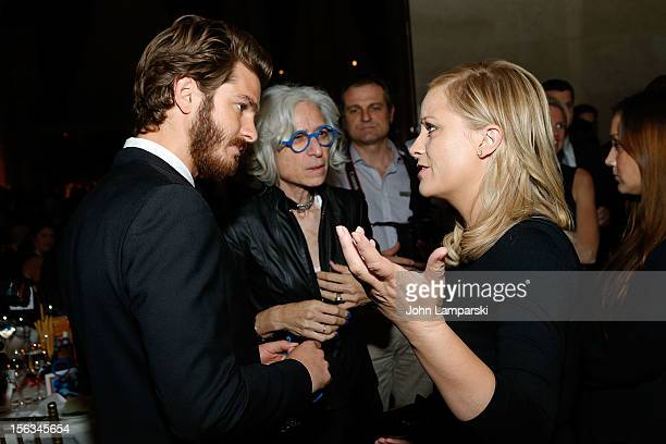 Amy Poehler DrJane Aronson and Andrew Garfield attend the 15th Anniversary Worldwide Orphans Benefit Gala at Cipriani Wall Street on November 13 2012...