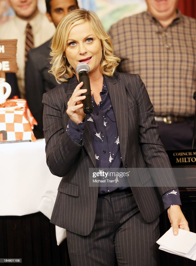 <a gi-track='captionPersonalityLinkClicked' href=/galleries/search?phrase=Amy+Poehler&family=editorial&specificpeople=228430 ng-click='$event.stopPropagation()'>Amy Poehler</a> speaks at the 'Parks And Recreation' 100th episode celebration held at CBS Studios - Radford on October 16, 2013 in Studio City, California.