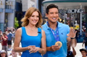 Amy Purdy and Mario Lopez visit 'Extra' at Universal Studios Hollywood on July 24 2014 in Universal City California