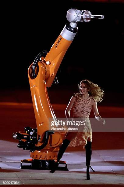 Amy Purdy dances with robot Kuka during the Opening Ceremony of the Rio 2016 Paralympic Games at Maracana Stadium on September 7 2016 in Rio de...