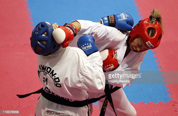 Amy Reeder of New Zealand and Nicola Konig of Germany compete in the Female Senior Team Sparring on the final day of the 2011 ITF TaekwonDo World...