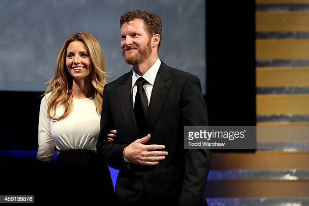 Amy Reimann and Dale Earnhardt Jr pose for a photo during the NASCAR Nationwide Series and NASCAR Camping World Truck Series Banquet at Trump...