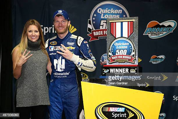 Amy Reimann celebrates with Dale Earnhardt Jr driver of the Nationwide Chevrolet in victory lane after Earnhardt won the rainshortened NASCAR Sprint...