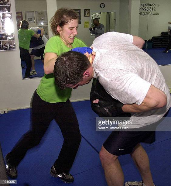 Amy Remsen practices defense techniques with Rob Watterson in a Krav Maga class April 9 2003 in Philadelphia Pennsylvania With the US at high terror...
