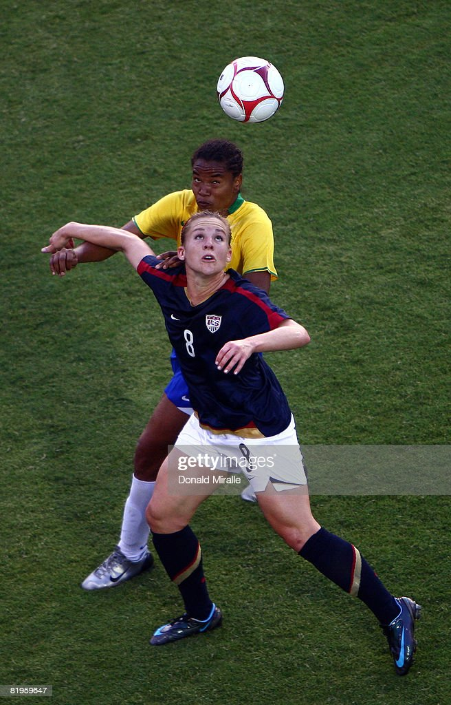 Amy Rodriguez of the United States and Renata Costa of Brazil fight battle for control of the ball against the USA during the International Friendly...