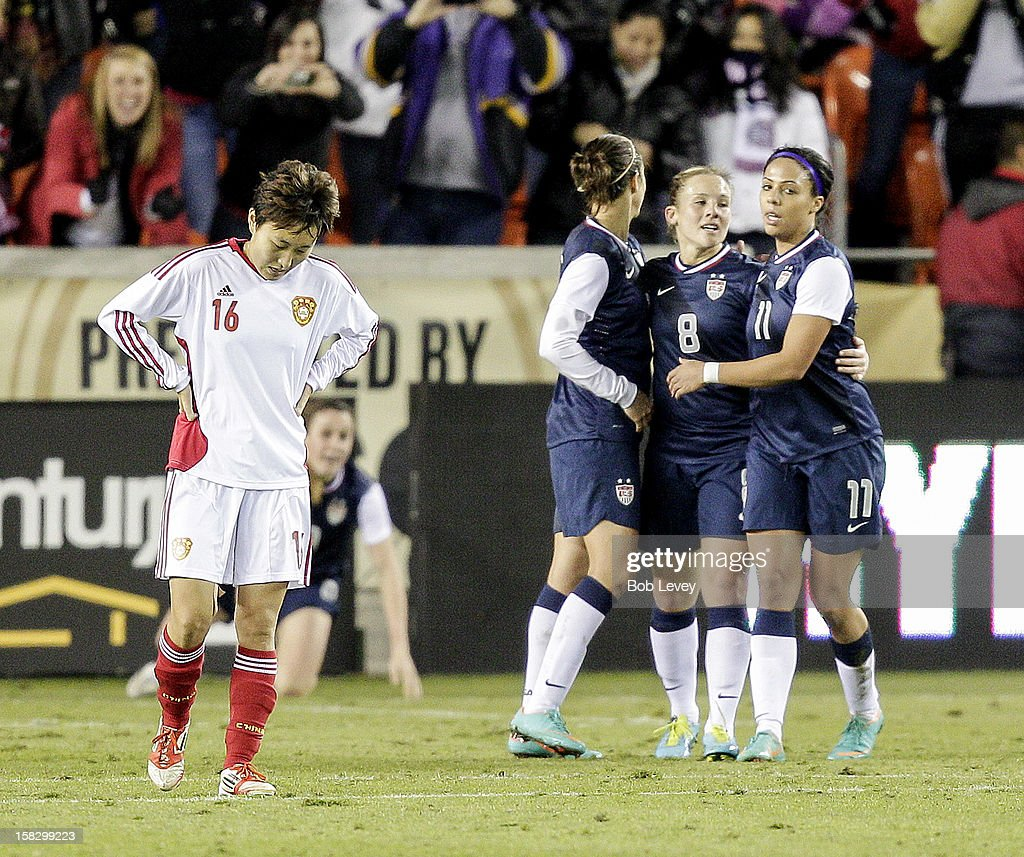 Amy Rodriguez (8) of the United States celebrates her goal with Sydney Leroux (11) and Alex Morgan (13) as Wang Chen (16) looks dejected in the second half at BBVA Compass Stadium on December 12, 2012 in Houston, Texas. USA won 4-0.