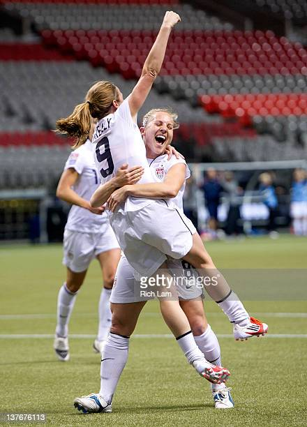 Amy Rodriguez of the United States congratulates teammate Heather O'Reilly after scoring against Mexico during first half of the 2012 CONCACAF Wome's...