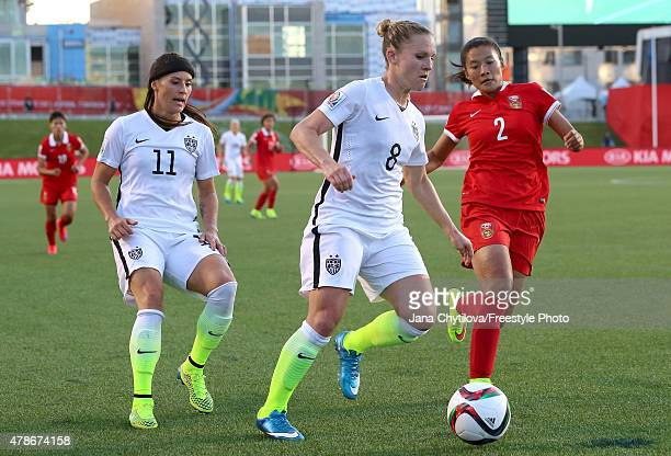 Amy Rodriguez of the United States controls the ball against Liu Shanshan of China in the first half in the FIFA Women's World Cup 2015 Quarter Final...