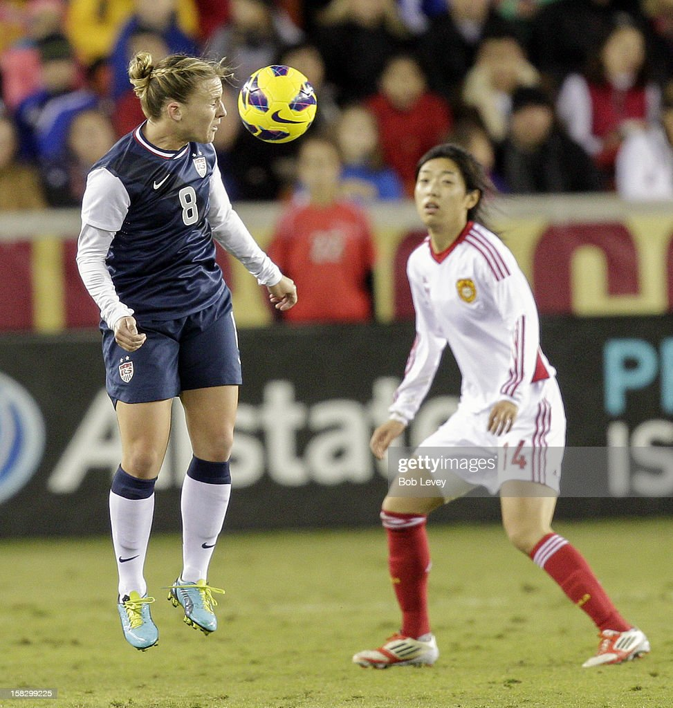 Amy Rodriguez (8) of the United States heads the ball away in the second half at BBVA Compass Stadium on December 12, 2012 in Houston, Texas. USA won 4-0.