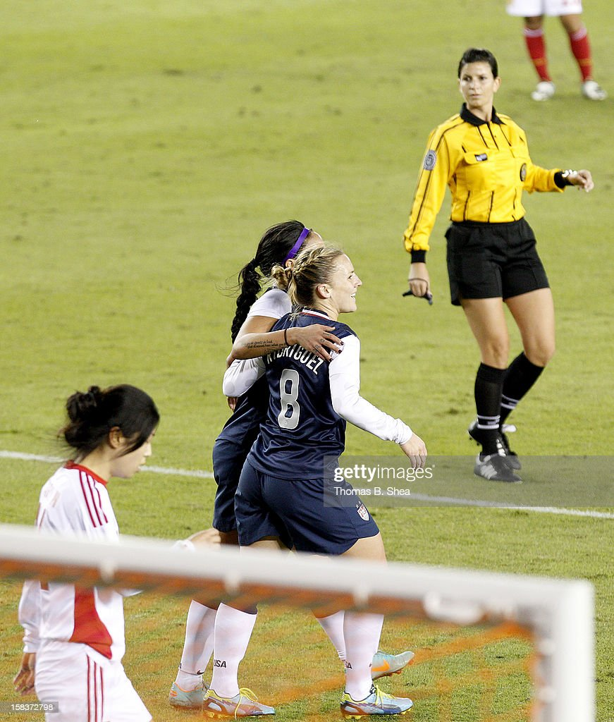 Amy Rodriguez #8 of the U.S. Women's National Team celebrates a goal against the China Women's National Team in an international friendly game at BBVA Compass Stadium on December 12, 2012 in Houston, Texas. USA won 4 to 0.