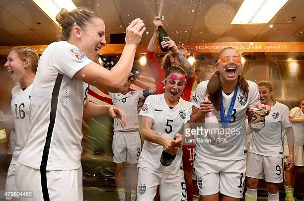 Amy Rodriguez of USA Kelly O'Hara of USA and Alex Morgan of USA celebrate in the locker room after the FIFA Women's World Cup 2015 Final between USA...