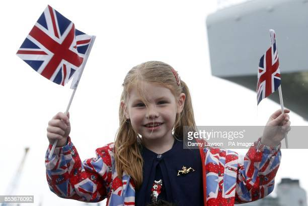 Amy Roslender as Queen Elizabeth II officially named Royal Navy's new aircraft carrier HMS Queen Elizabeth during a visit to Rosyth dockyard in...