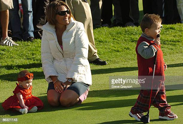 Amy Sabbbatini daughter Tylie Jo and son Harley look on as husband Rory Sabbatini receives his trophy on the 18th green after winning the 2006 Nissan...