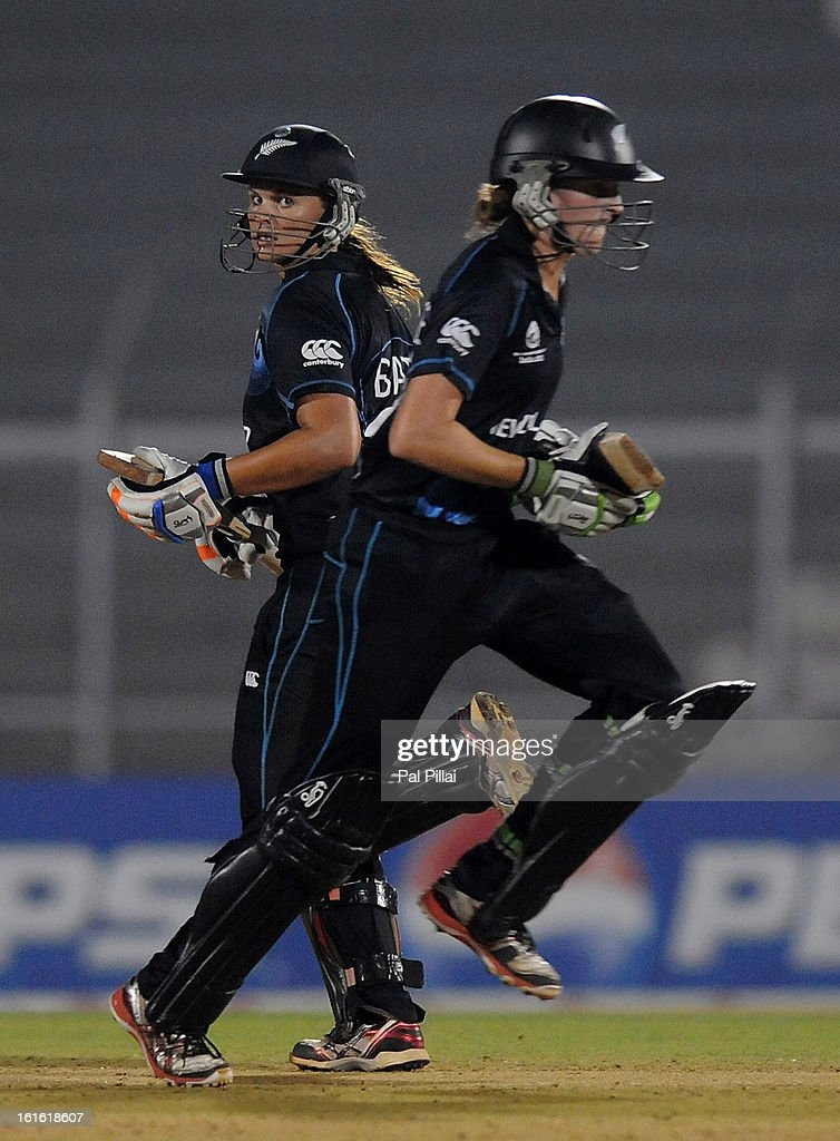 Amy Satterthwaite and Suzie Bates captain of New Zealand run between the wickets during the Super Sixes match between England and New Zealand held at the Cricket Club of India on February 13, 2013 in Mumbai, India.