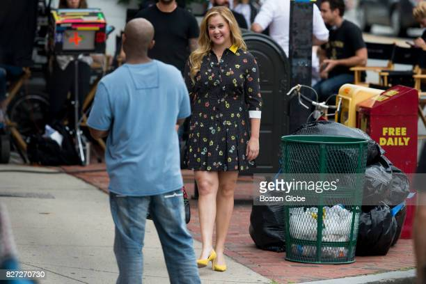 Amy Schumer talks with an extra on the set of a new movie filming on Tremont Street in Boston on Aug 7 2017