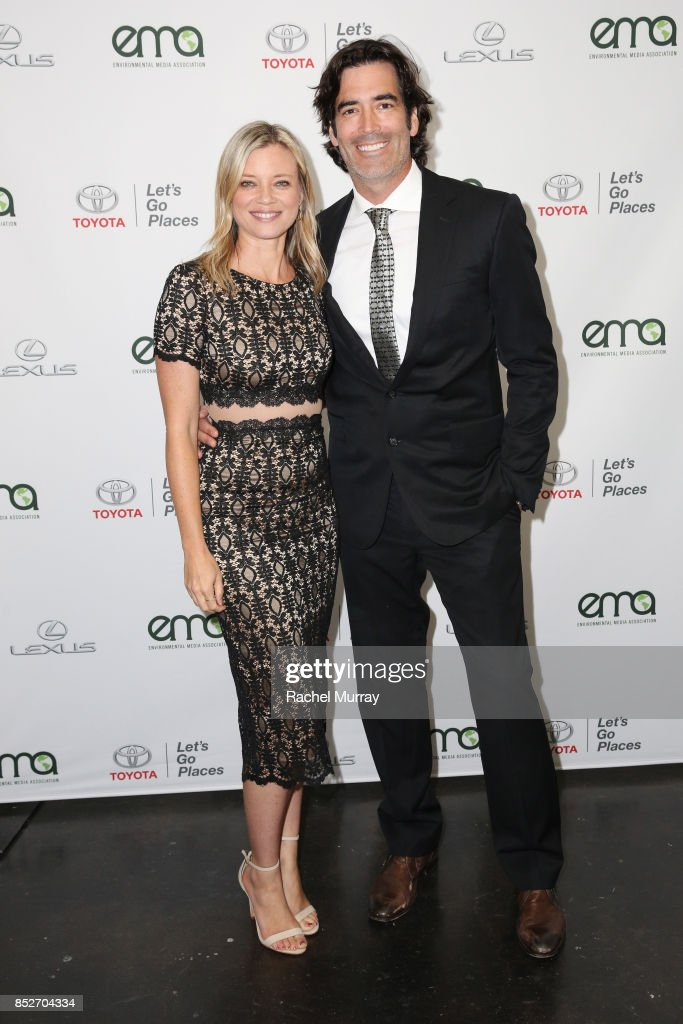 Amy Smart (L) and Carter Oosterhouse at the Environmental Media Association's 27th Annual EMA Awards at Barkar Hangar on September 23, 2017 in Santa Monica, California.