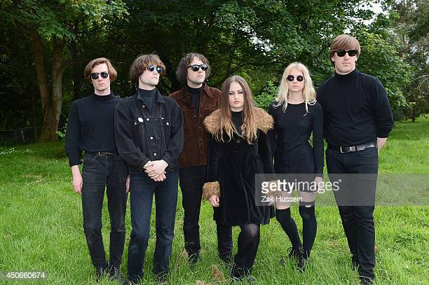Amy Studt and Band pose backstage at The Isle of Wight Festival at Seaclose Park on June 15 2014 in Newport Isle of Wight
