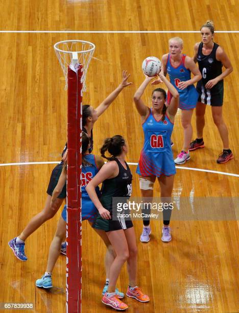 Amy Summerville of the Waratahs shoots for goal during the round six ANL match between the Netball NSW Waratahs and the Tasmanian Magpies at Sydney...