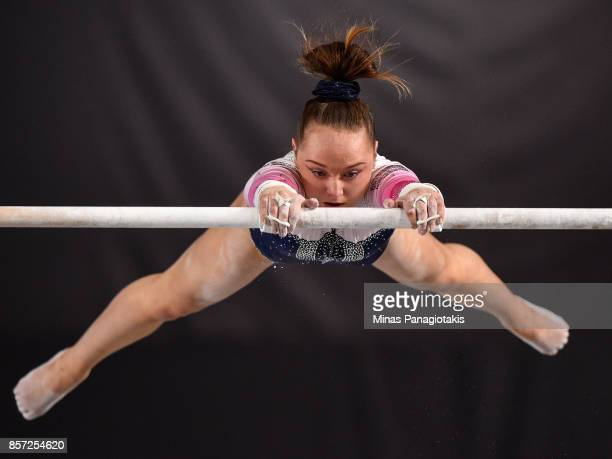 Amy Tinkler of Great Britain competes on the uneven bars during the qualification round of the Artistic Gymnastics World Championships on October 3...