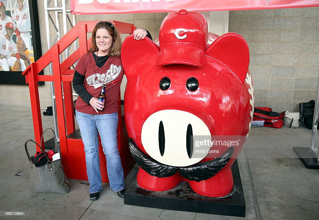 Amy Venable poses with a large piggy bank before the start of the Los Angeles Angels of Anaheim game against the Cincinnati Reds at Great American Ball Park on April 1, 2013 in Cincinnati, Ohio.
