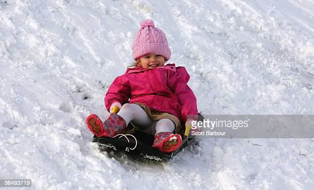 Amy Ward slides down a snow covered hill on December 28 2005 in Hastings England Wintery weather has hit parts of Britain with the belowfreezing...
