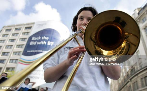 Amy Wetmore a member of the London Philharmonic Orchestra Scholarship Scheme plays the trombone in central London to symbolise one 'Voice of London'...