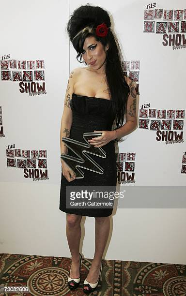 Amy Whinehouse poses with the Pop award for 'Back to Black' at the South Bank Show Awards at the Savoy Hotel on January 23 2007 in London England