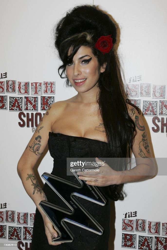 Amy Whinehouse poses with the Pop award for 'Back to Black' at the South Bank Show Awards at the Savoy Hotel on January 23, 2007 in London, England.