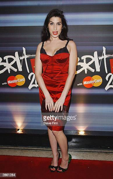 Amy Winehouse arrives at the announcement of the shortlist for The Brit Awards 2004 at the Park Lane Hotel on January 12 2004 in LondonThe Brits...