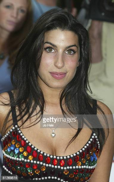 Amy Winehouse arrives at the annual 'Nationwide Mercury Music Prize' at the Grosvenor House on September 7 2004 in London Making the 12album...