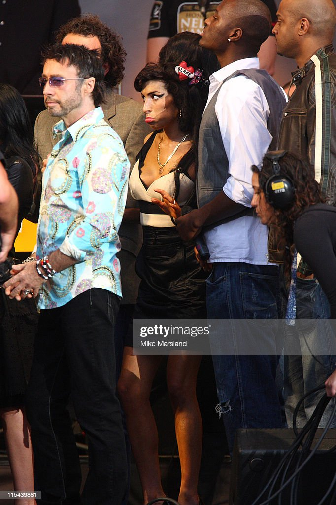 Amy Winehouse attends the 46664 Concert part of Nelson Mandela 90th birthday celebrations on June 27, 2008 at Hyde Park in London. Singer Paul Rodgers is also present.