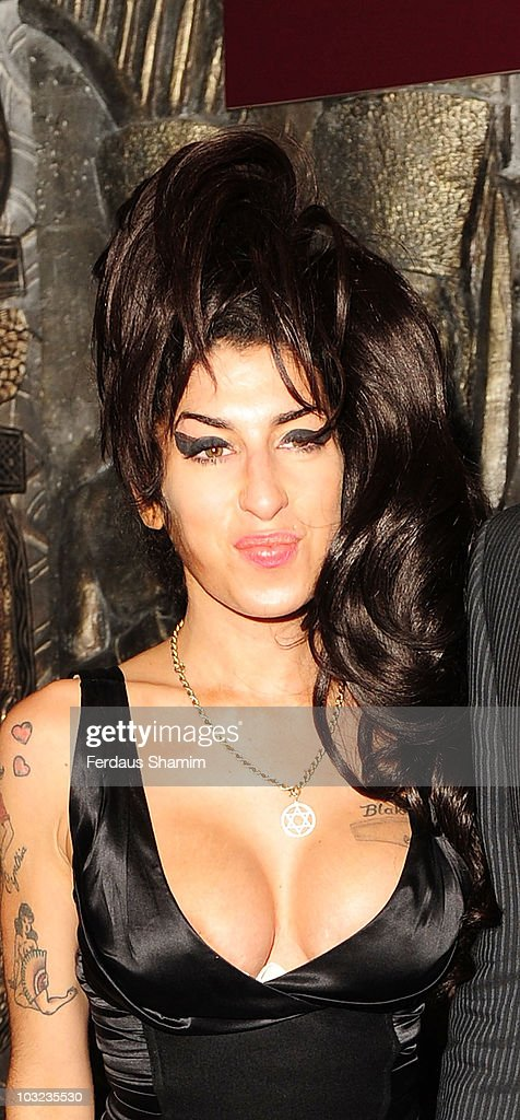Amy Winehouse attends the launch of the Shaka Zulu bar on August 4, 2010 in London, England.