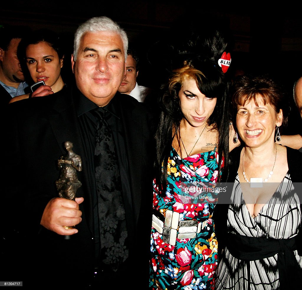 <a gi-track='captionPersonalityLinkClicked' href=/galleries/search?phrase=Amy+Winehouse&family=editorial&specificpeople=201684 ng-click='$event.stopPropagation()'>Amy Winehouse</a>, her father Mitch and mother Janis pose with Amy's award for Best Song Musically and Lyrically for 'Love Is A Losing Game' at the 53rd Ivor Novello Awards at the Grosvenor House Hotel on May 22, 2008 in London, England.