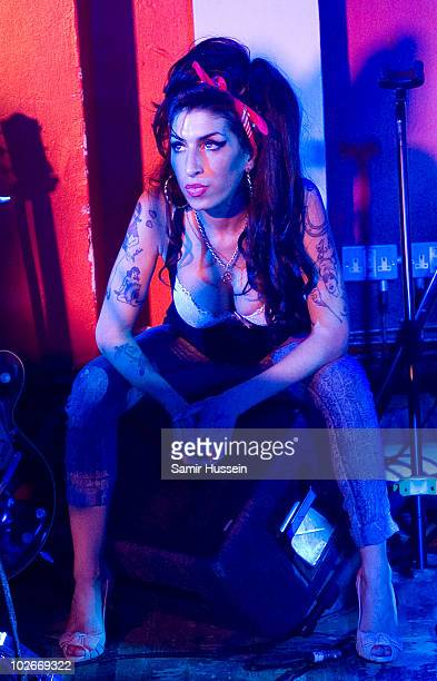 Amy Winehouse makes a surprise appearance with Mark Ronson at the 100 Club on July 6 2010 in London England