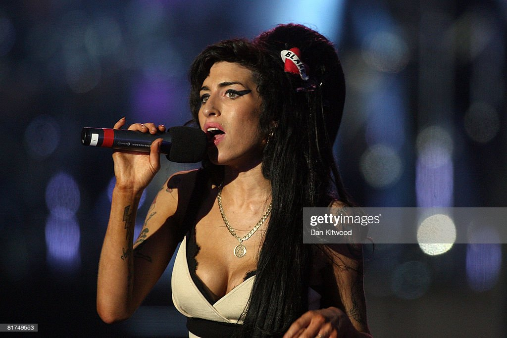 <a gi-track='captionPersonalityLinkClicked' href=/galleries/search?phrase=Amy+Winehouse&family=editorial&specificpeople=201684 ng-click='$event.stopPropagation()'>Amy Winehouse</a> performs during the 46664 concert in celebration of Nelson Mandela's life at Hyde Park on June 27, 2008 in London, England.