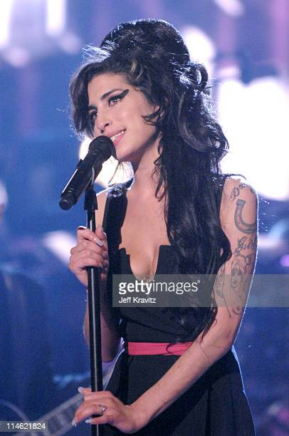 Amy Winehouse performs 'Rehab' during 2007 MTV Movie Awards Show at Gibson Amphitheater in Los Angeles California United States